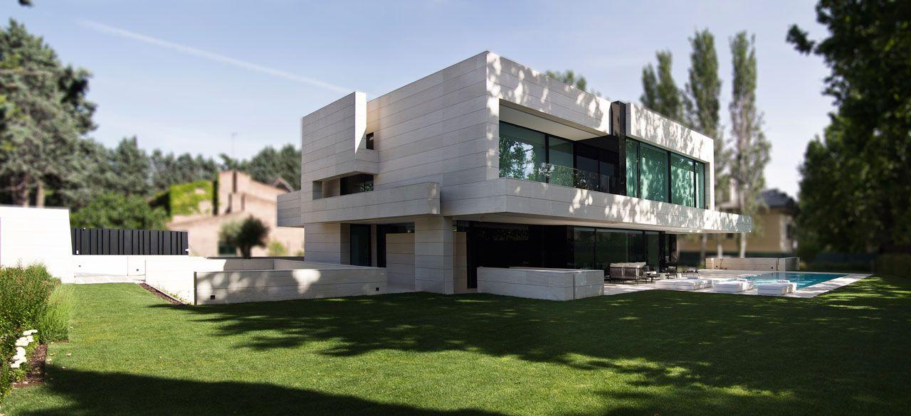 Modern Home Made of Limestone & Black Glass | Black glass ...
