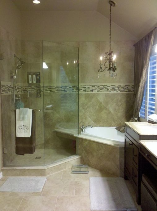 Master Bath With Chandelier New Frameless Glass Shower And Corner Tub Tile Border Made Of Marble Natural Stone