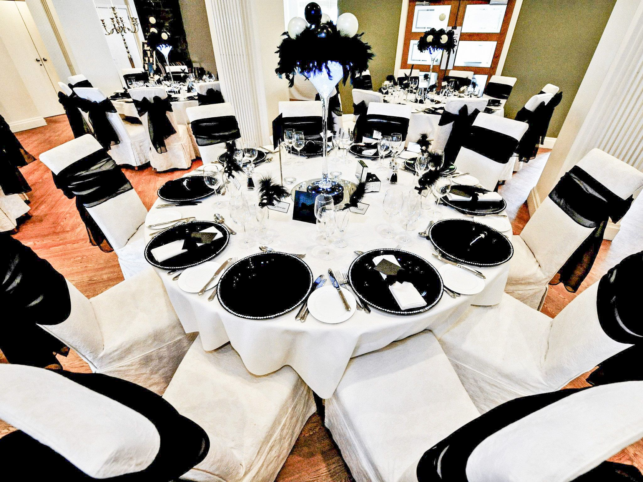 Wedding table centrepieces with martini vase and black charger ...