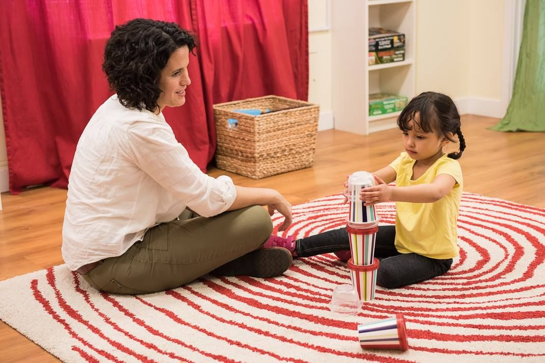 Using items like cups, take turns stacking with your child