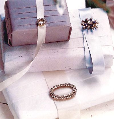 the palest lavender with vintage jewelry embellishments