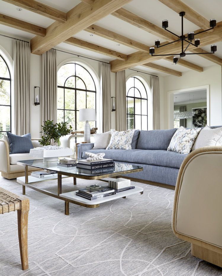 Ivory And Blue Family Room With Arched Windows And Light