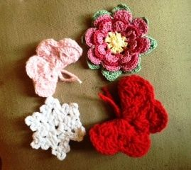 The butterflies will be attached to shawls going to Dover Air Force Base, the snow flake will be attached to a hat for Ronald's House, and the flower I'll attach to a tote bag for me. :)