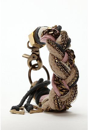 Make it yourself.. braided bracelet out of random fabric/rope and old necklaces and chains that will never be worn again.