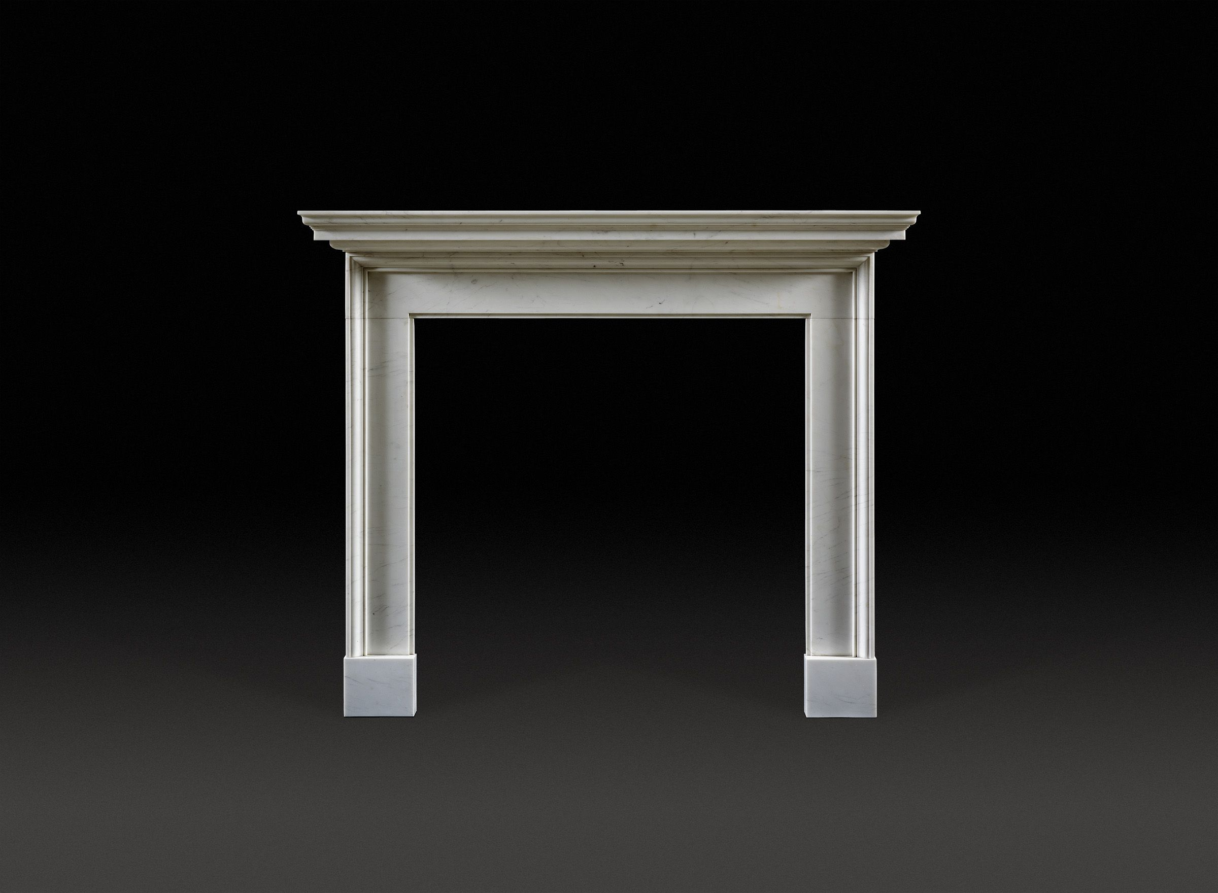a simple but well drawn and proportionately designed fireplace