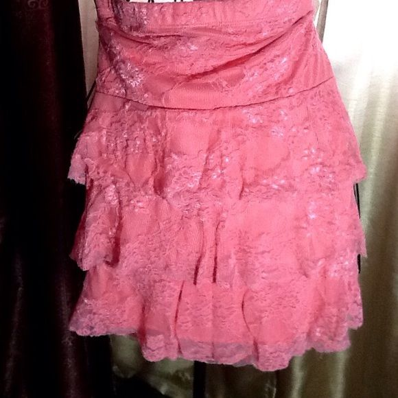 LAYERED RUFFLED LACY PEACH COLORED SKIRT  Peach colored lacy 3 layers of ruffled stretchy knit skirt.  Nylon and spandex.  Polyester lining.  Ruffles only in front.  Stretch waistband. Rue 21 Skirts Mini