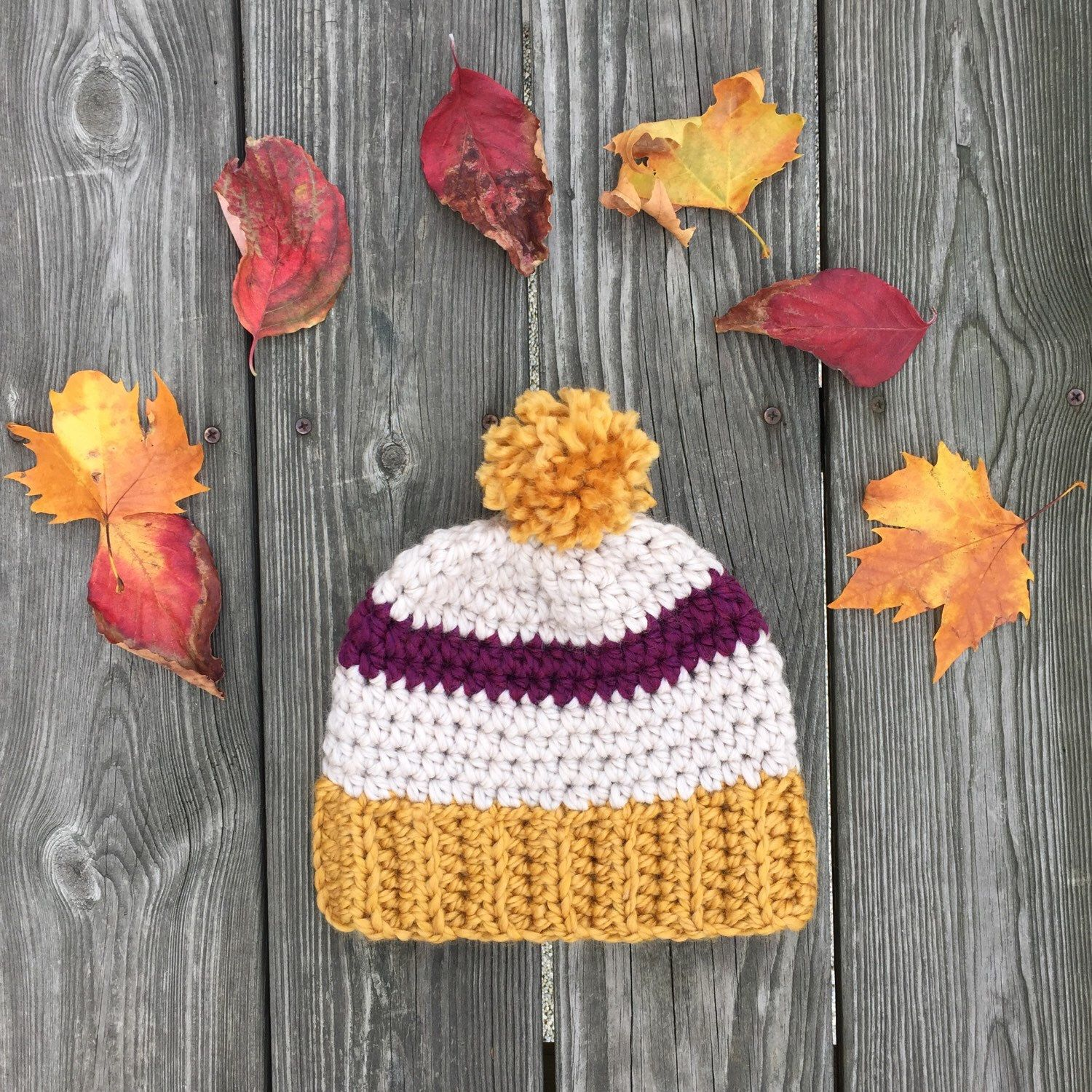 A personal favorite from my Etsy shop https://www.etsy.com/listing/253606225/mustard-plum-slouchy-crochet-pom-pom-hat