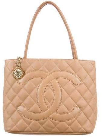 725aefb61768d7 #Chanel Caviar Medallion #Tote. Beige quilted Caviar leather Chanel  Medallion tote with gold-tone hardware, dual rolled shoulder straps,  stitched CC logo ...