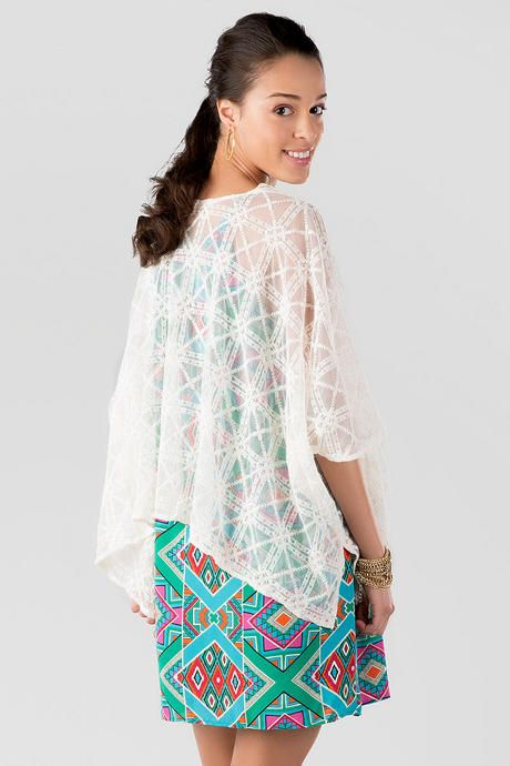 "The Harper Lace Kimono is perfect for layering over a strapless dress or tank!  This ivory embroidered lace kimono will add texture & a feminine touch to any outfit. Wrap this kimono around any tank or dress for a finished look.    <br><br>   -	28"" length shoulder to hem <br> -	Measured from a small<br><br> -	80% Cotton, 20% Nylon <br> -	Dry Clean Only<br> -	Imported<br>"