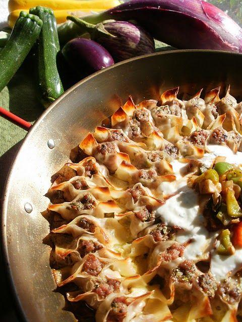 Manti ( Turkish ravioli ). Top with garlic and yogurt sauce,