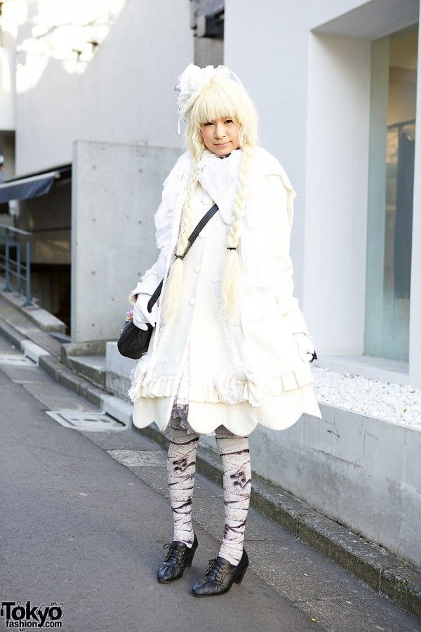 Ruru is a Japanese college student who is active in several Harajuku subcultures, including lolita and shironuri. She makes a lot of her own clothing and here she's wearing a handmade dress with lace, ruffle & scallop details. Other items include an h.NAOTO Frill hat, Dangerous Nude mummy tights & an Axes Femme cat bag. #tokyofashion #street snap #Harajuku