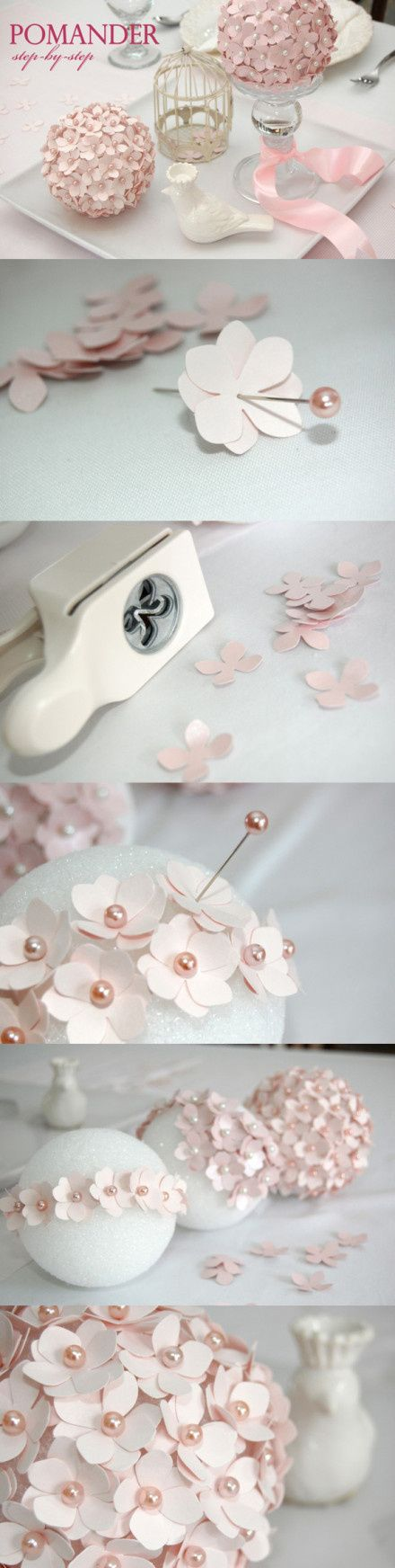 Styrofoam ball, rose gold and pearl colored pins, flower hole punch and printed paper, pin two on each. Love this make one to hang from calling or put on top candle stick holder spray painted