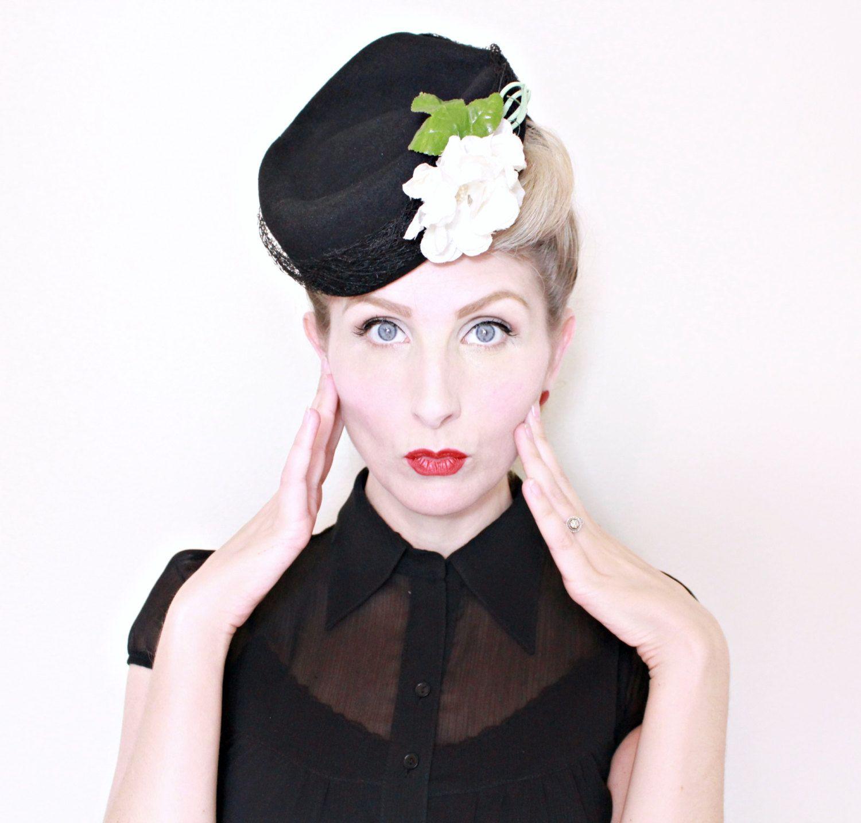 Black felt headdress with white flowers