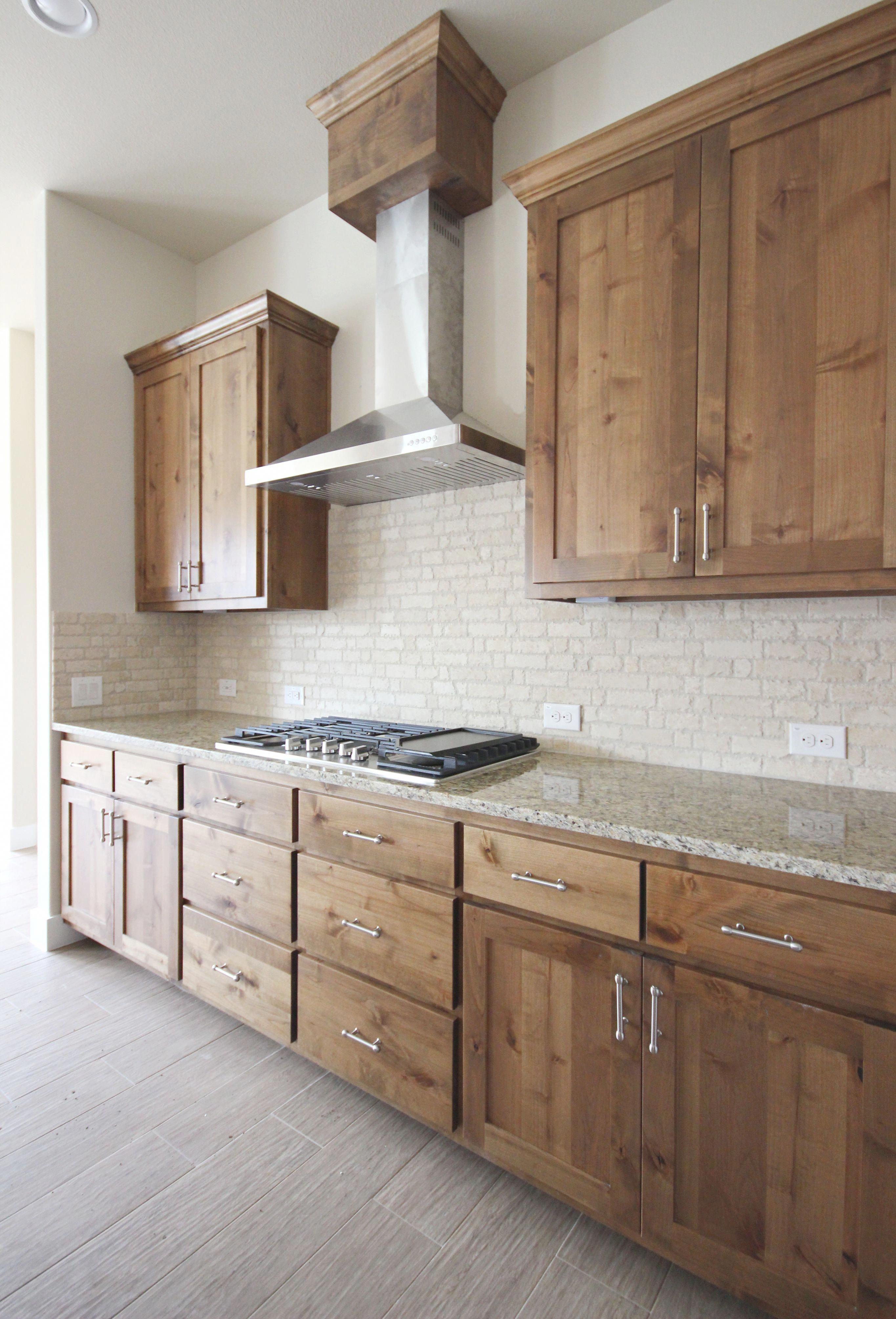 Modern Kitchen With Wood Knotty Alder Cabinetry Galleykitchen In 2020 Alder Kitchen Cabinets Rustic Modern Kitchen Rustic Kitchen