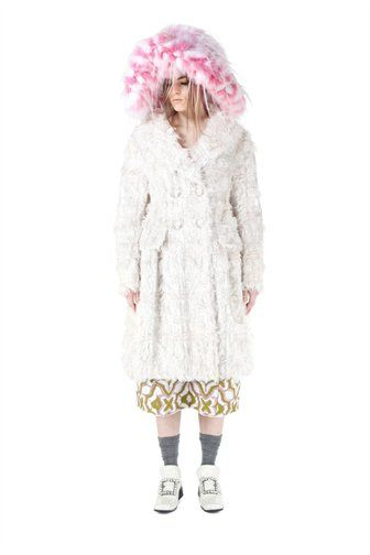 Double breasted light pink coat with all over shaggy mohair and sequin embroidery. Double-faced construction with wide collar and four-button closure.