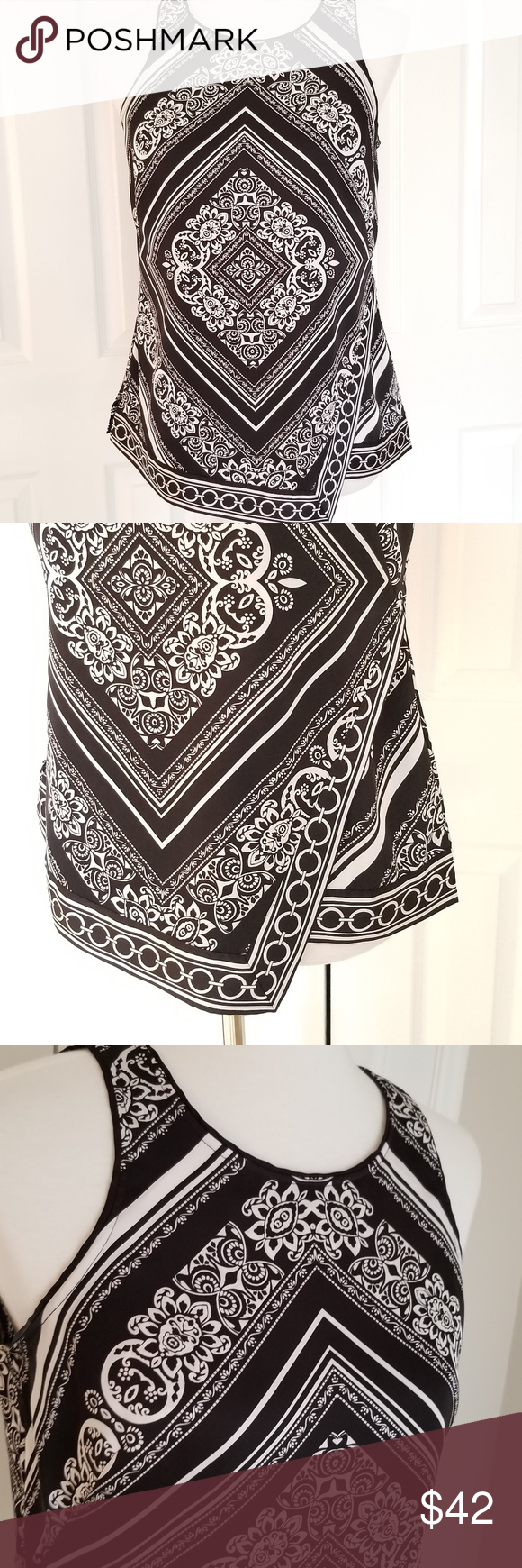 """WHBM Top Wrap Look - Size Small - EUC!! Beautiful WHBM top with faux wrap look in front of top.   Black piping along neck line and arm holes.  Long hidden zip in back of top with a keyhole design and silver button.  No flaws or issues, just beautiful!!  Fabric 98% polyester and 2% Spandex.  Approximate Measurements:  Bust: 18""""  Waist: 17""""  Length: 24.5""""  non-smoking home  ship same or next business day  Open to questions and offers! White House Black Market Tops Blouses"""