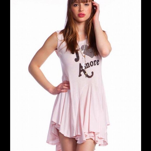 Wildfox Pink Dress Adorable wear anywhere dress. This is a designer Wildfox comfy and super flattering light pink dress with the words J 'Adore. Only worn once. Wildfox Dresses