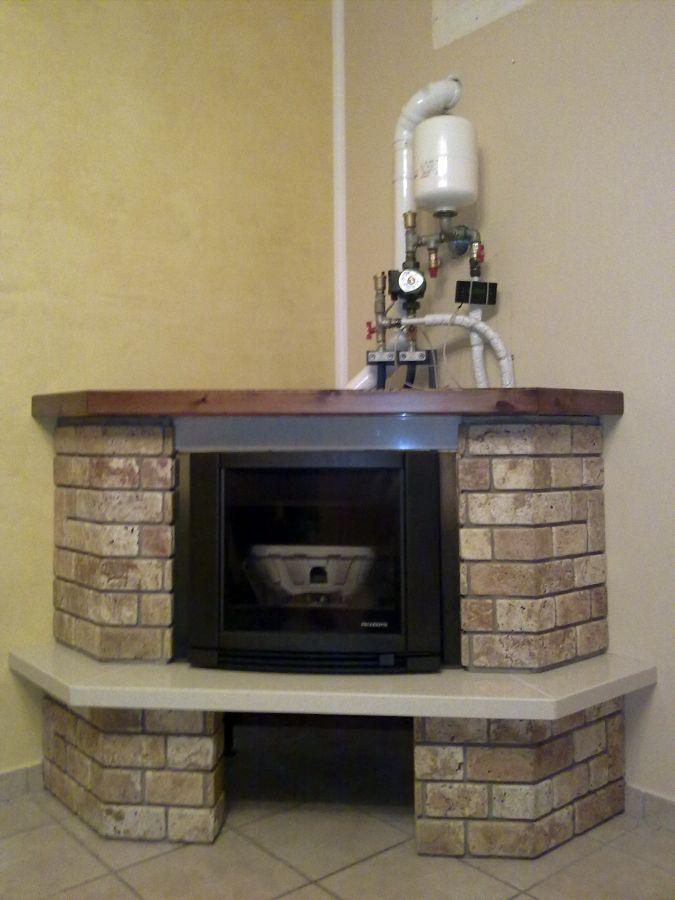 Foto: termocamino a pellet palazzetti rivestimento rustico ...