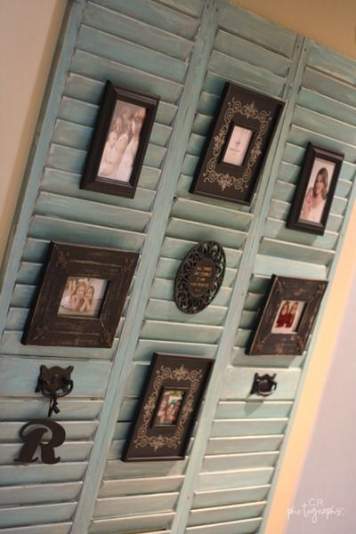 Old shutters to display pictures. Tuck the frame easel between the slats.