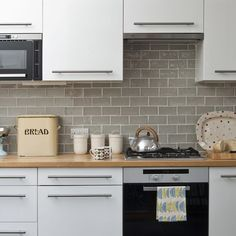 Paint Your Kitchen Cabinets Update Your Kitchen On A Budget - Country kitchen splashback ideas