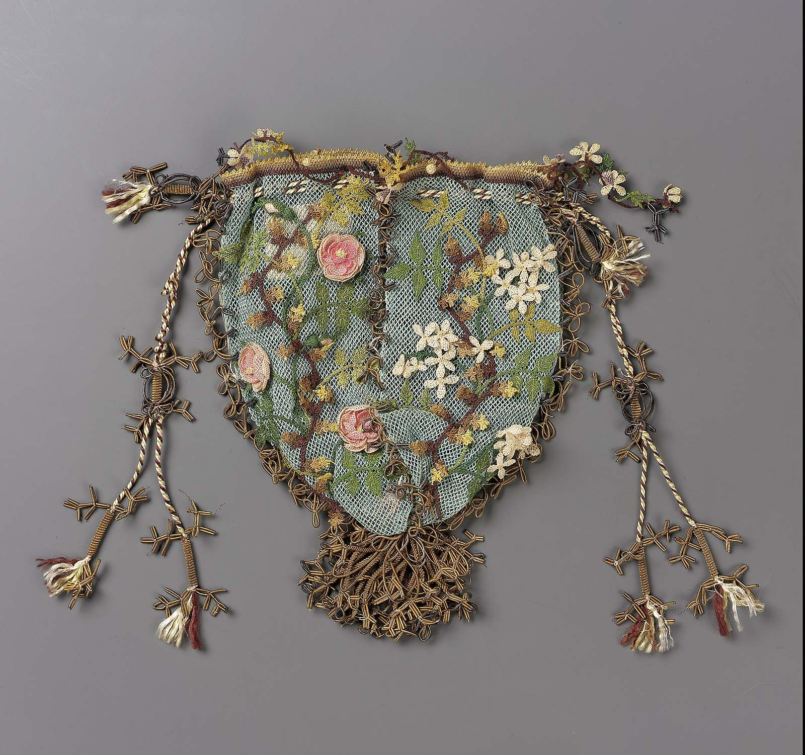 Lace bag made of silk net with silk bibila lace, gilt metal thread and tassels, and silk cording and was made in the 1800s.