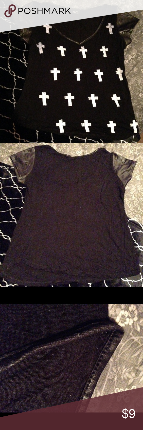 Pleather sleeves top Black top with pleather sleeves, white crosses on front. Rue 21 Tops