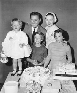 Errol Flynn and his 3rd wife Patrice with their daughter