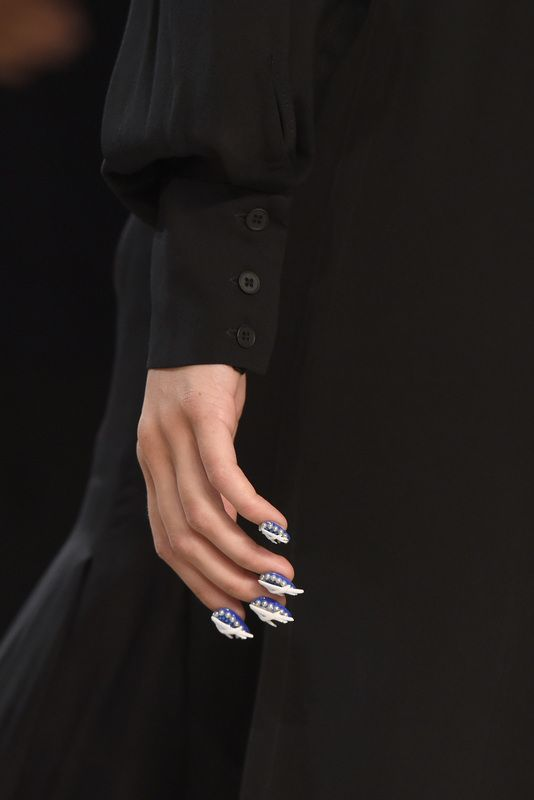As nail designs continue to push limits, both on and off of the runways, we see nail art breaking past the classic negative space and ombre designs in the nail world and becoming mini canvases for art to be displayed down the runways and sidewalks alike.