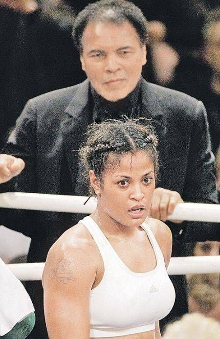 Female boxer Laila Ali poses with her father, former boxer, Muhammad Ali,  after defeating Suzy Taylor after two rounds at the Aladdin Casino on  August 17, ...
