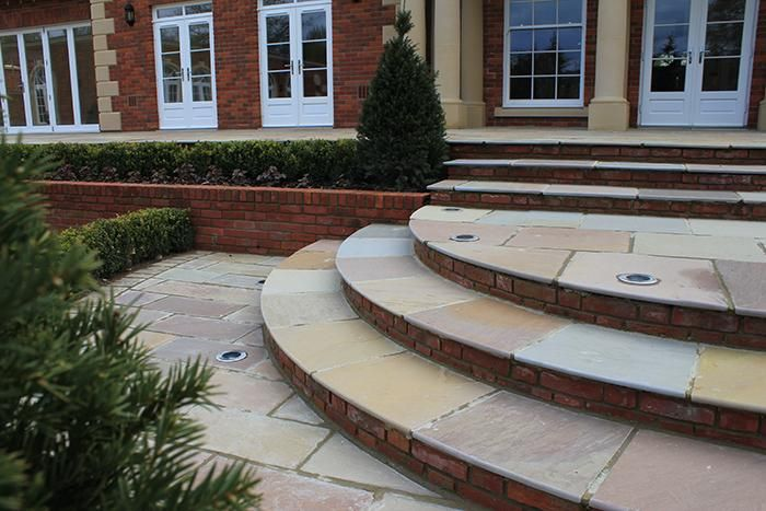 A Bespoke Shape, Such As These Curved Steps Used By Landart, Can  Immediately Add