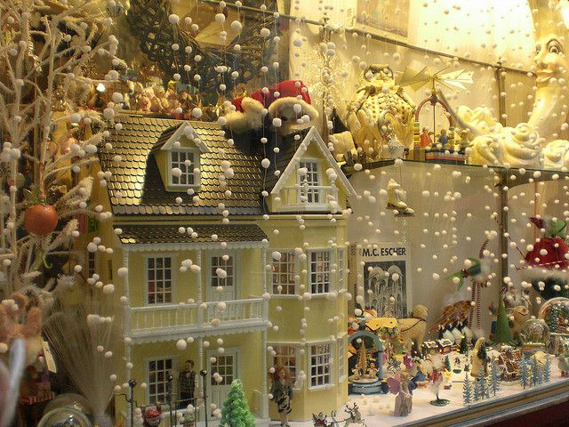 Christmas display in a toy shop-love the pom poms as snow