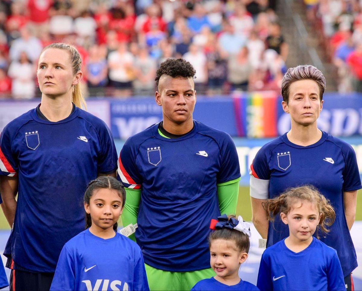 USA forward Sam Mewis 3, goalkeeper Adrianna Franch 21