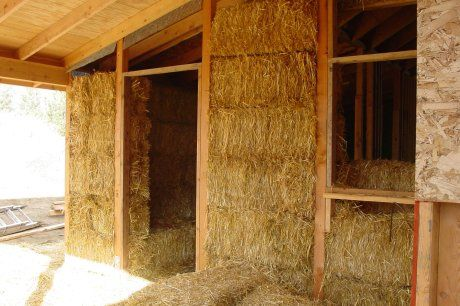 House · Straw Bale Construction With Bale Stacked In Wood Frame