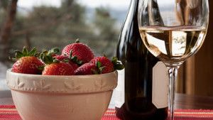 Wine and strawberries are some anti-aging foods for women over 50.