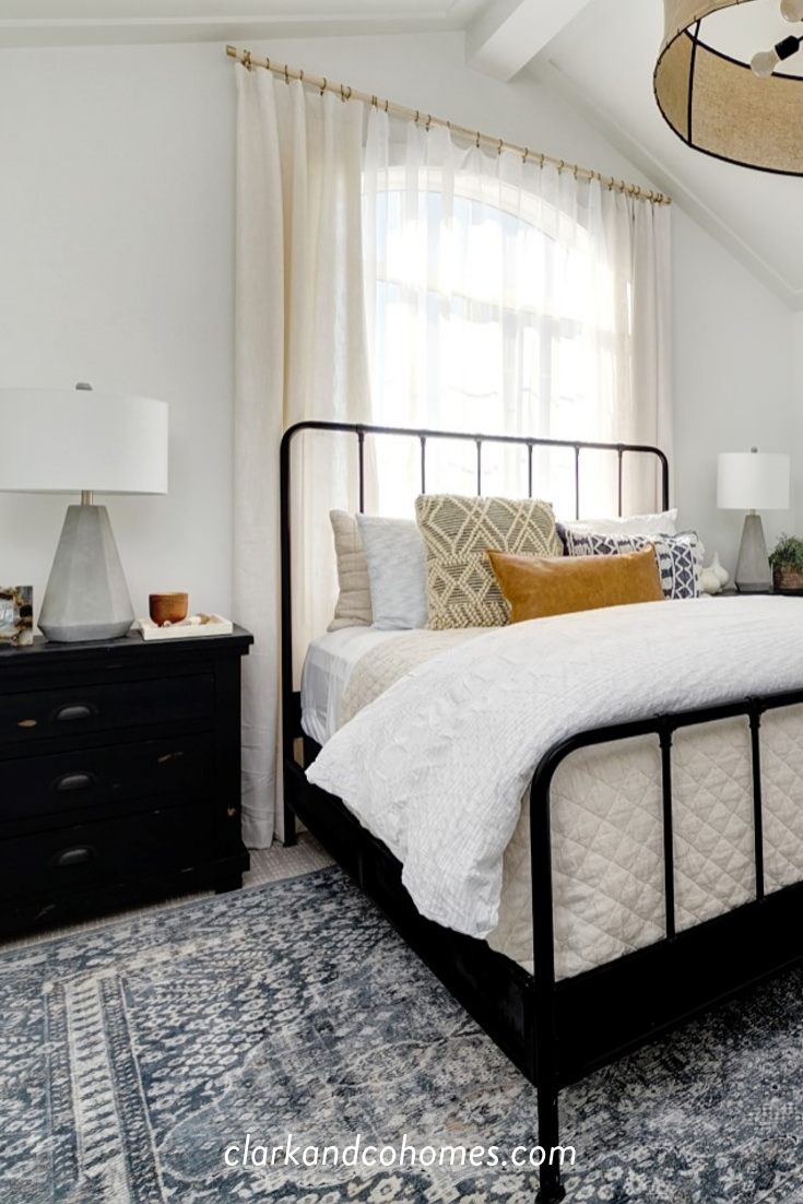 Black Wood Nightstands Tie Into The Wrought Iron Bed Frame Adding Substance To The Otherwise Tonal Wrought Iron Bed Frames Iron Bed Frame Black Wood Bed Frame