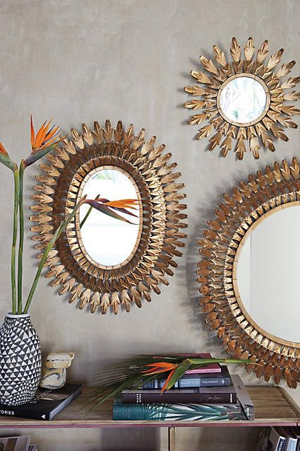 Beautiful mirrors grouped together bring light in to the room.