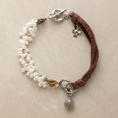 Two Part Harmony Bracelet  A double strand of freshwater pearls runs between turrets of cognac quartz and smoky quartz beads and attaches to a leather cord with two beaded sterling silver rings.