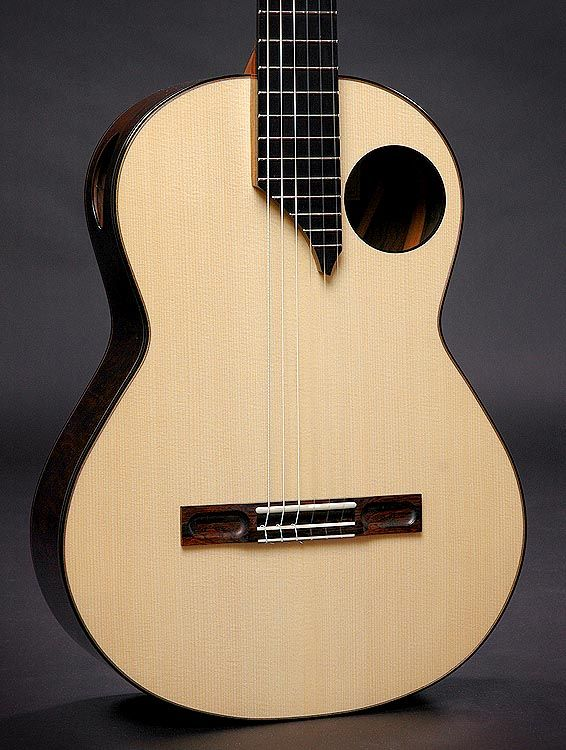 The C3 Features An Offset Soundhole Along With A Secondary Side Port