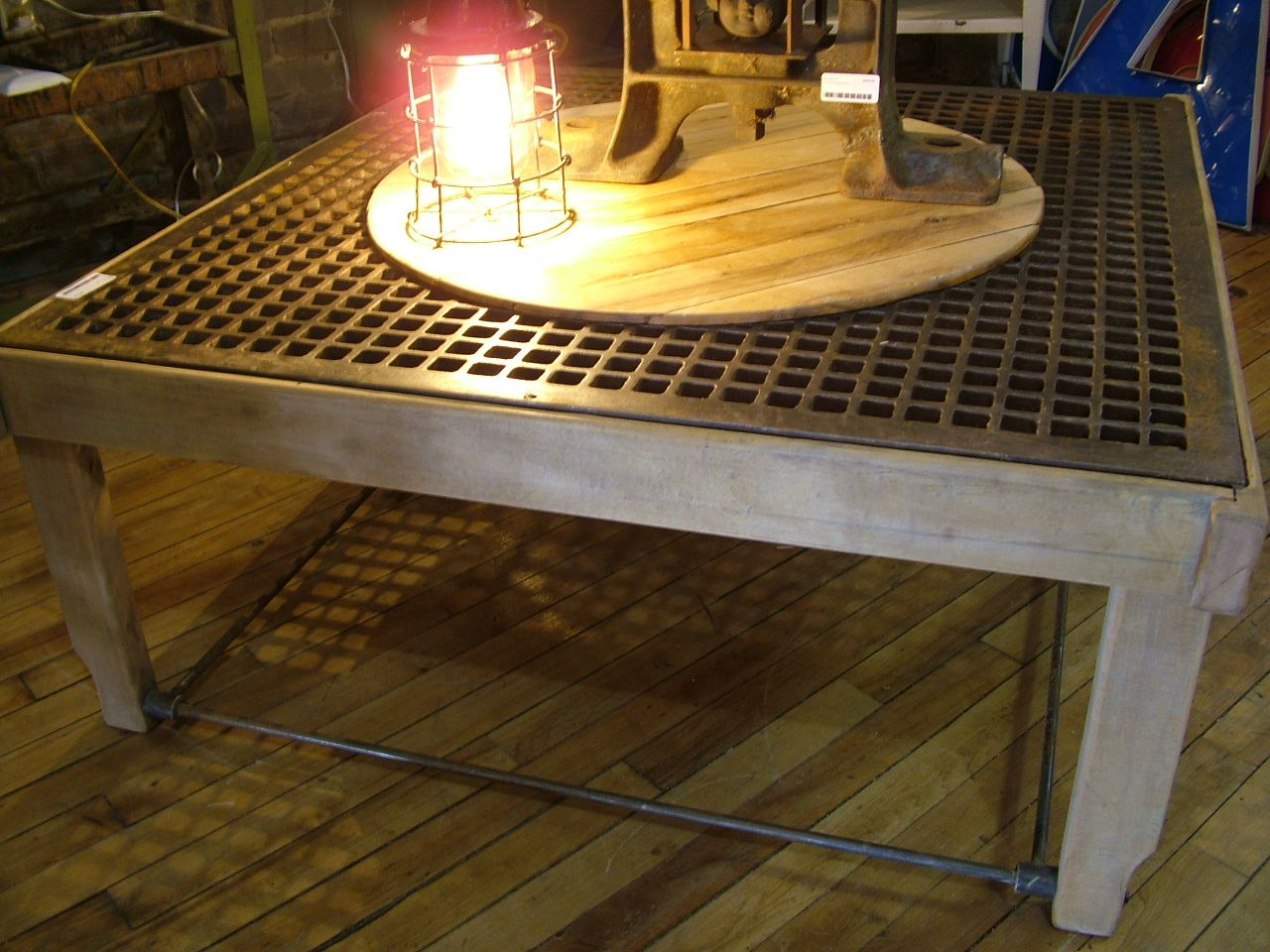 Coffee table made from cast iron floor grate surround.  Vintage