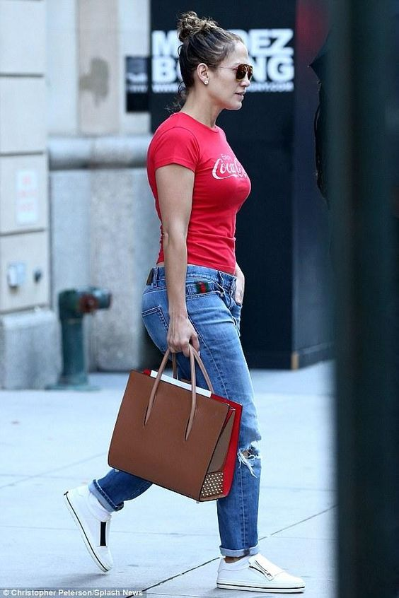 Jennifer Lopez wearing Gucci Boyfriend Straight Leg Jeans, Christian Louboutin Paloma Large Noisette Tote Bag, Roger Vivier Sneaky Viv Zip Sneakers and Topshop Coca Cola Graphic Tee