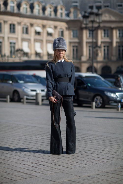 Only the confident can wear a furry hat like this with success.   - HarpersBAZAAR.com