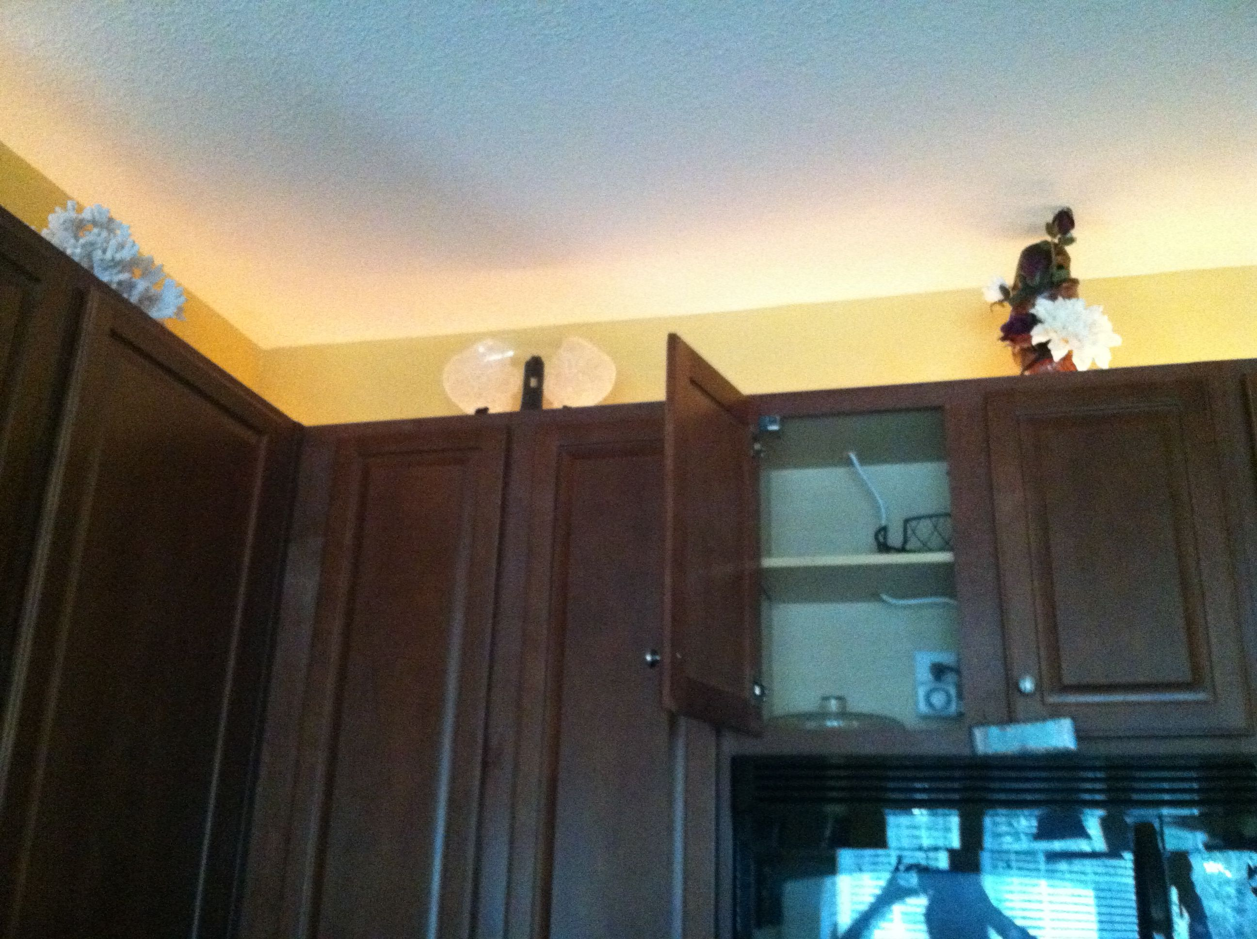Rope Light Plugged In Above The Microwave Drilled A Hole Threw The Top Of The Cabinet Kitchen Redo Rope Light Kitchen Cabinets