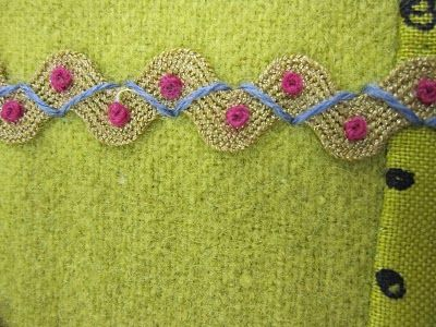 Great rick-rack treatment for pillow or childs dress or a jacket for me!  Sue Spargo: October 2010