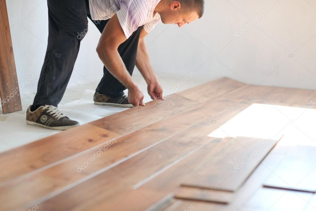 Man Installing laminate flooring Stock Photo , AFF,