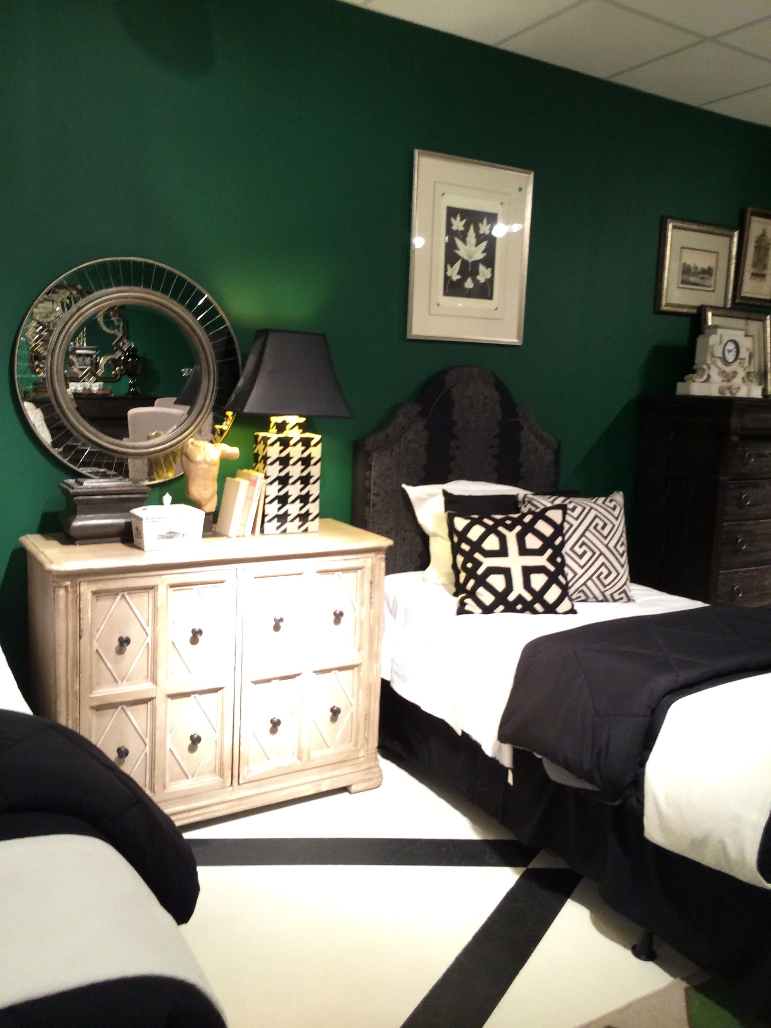 British racing green walls nicely contrast with the white Green and black bedroom