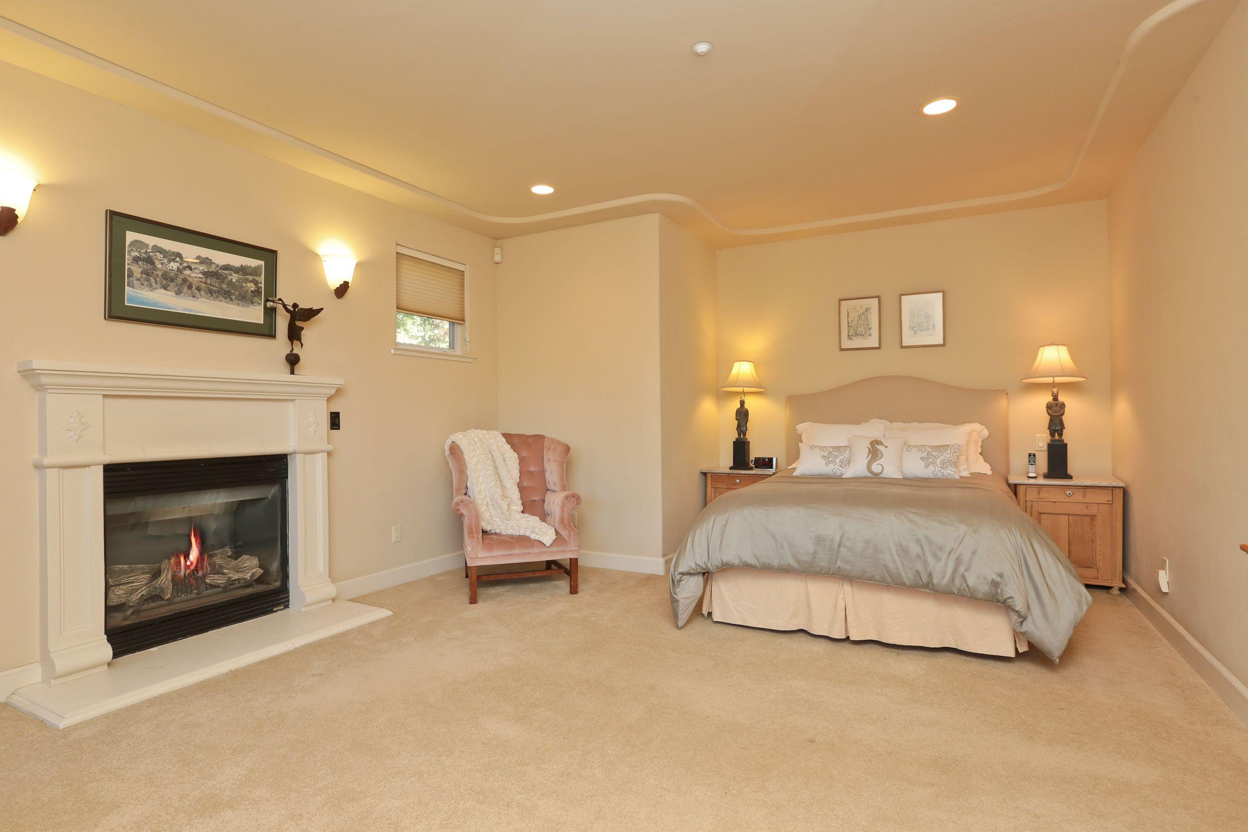 Master bedroom huge  Huge Master Bedroom Suite with fireplace and substantial floor space