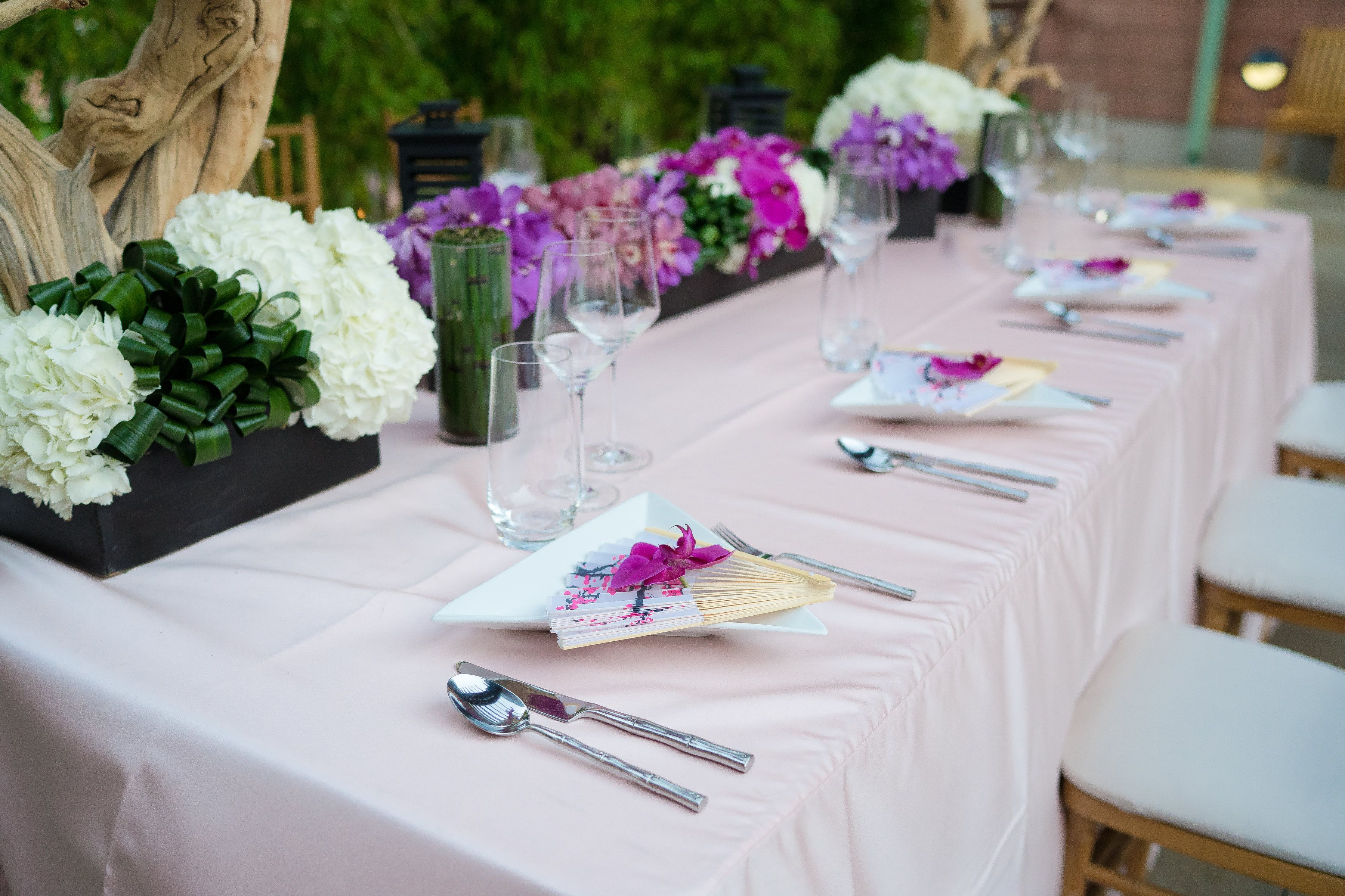 Mulan inspired table setting in a beautiful outdoor reception space ...