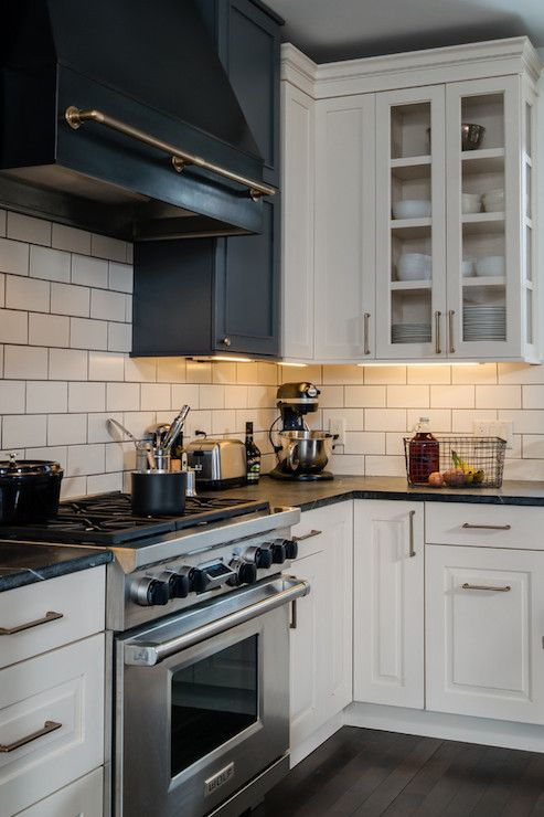 Beautiful Kitchen With White Raised Panel Cabinets Paired With Brass