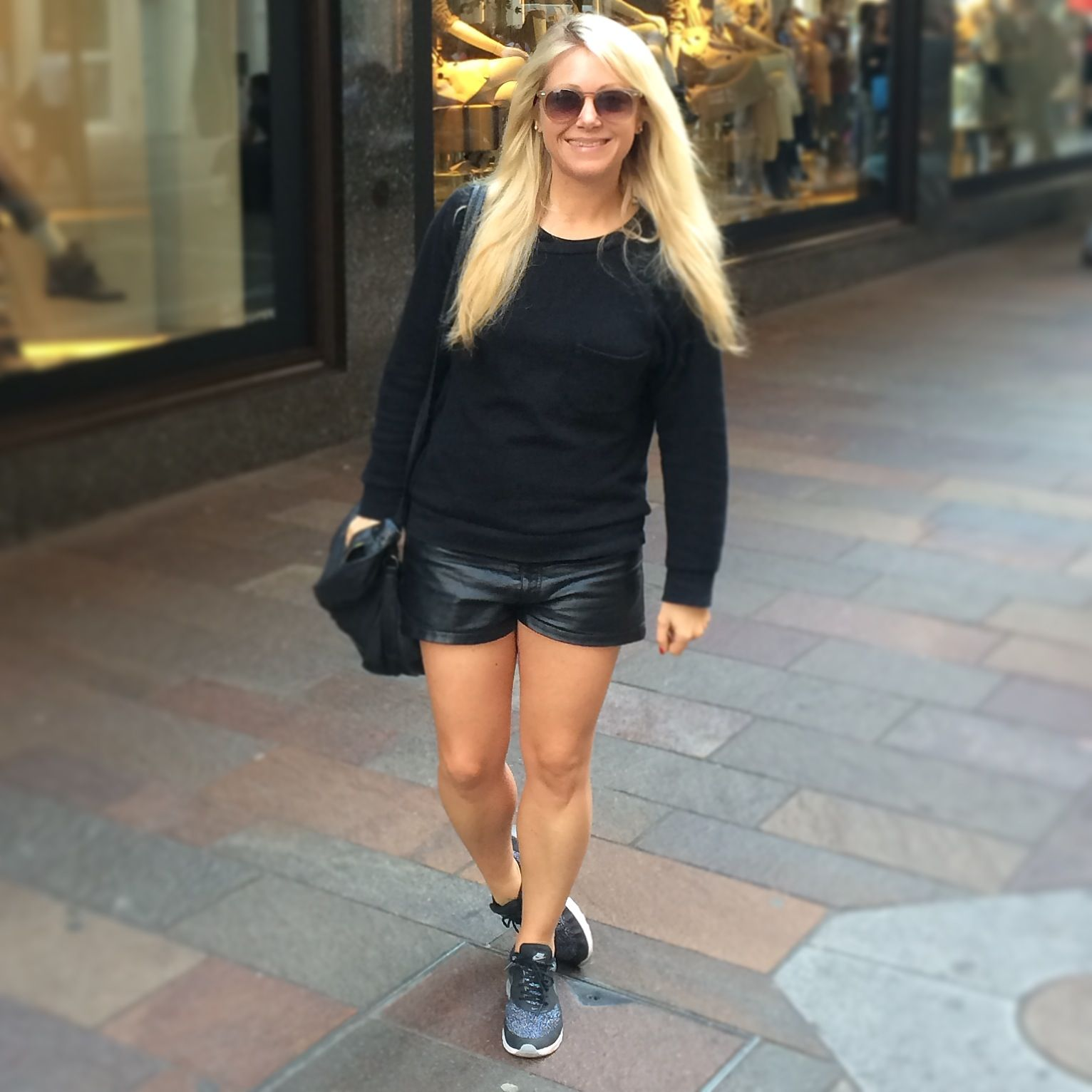 Black Topshop jumper, Leather Shorts, Nike Air Max Thea trainers