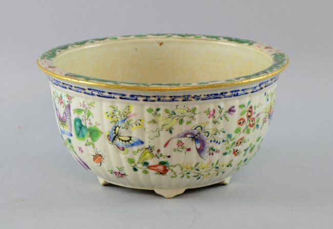 Mid 19th Century Chien-Lung white glazed porcelain jardiniere decorated in colours with butterflies, insects including cockroaches and beetles, 23.5cm diameter